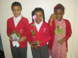 Some of the children show off their plants