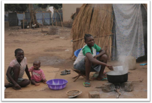 A woman cooks in front of her tent at the camp at the Catholic Mission early morning in Bossangoa.